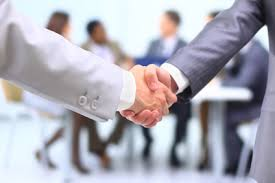 The handshake after the deal is sealed